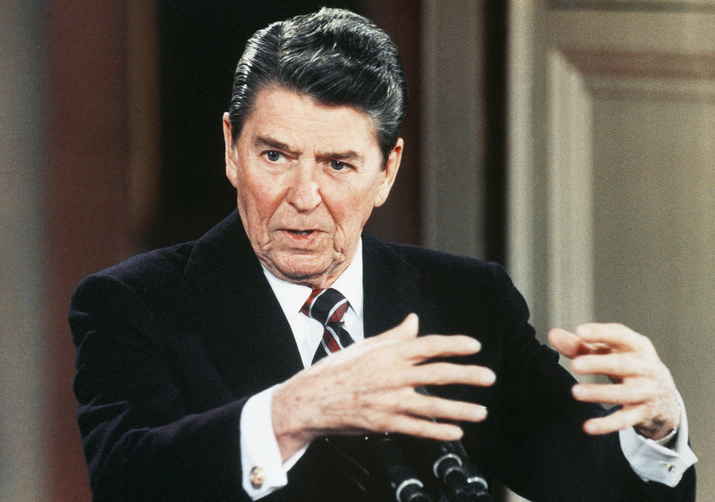 """. United States President Ronald Reagan gestures during a news conference at the White House, Washington, in January 1986 at which he said that there was \""""irrefutable evidence\"""" that Libyan leader Colonel Moammar Gadhafi was involved in the airport massacres in Rome and Vienna in December 1985. (AP Photo/Scott Stewart)"""