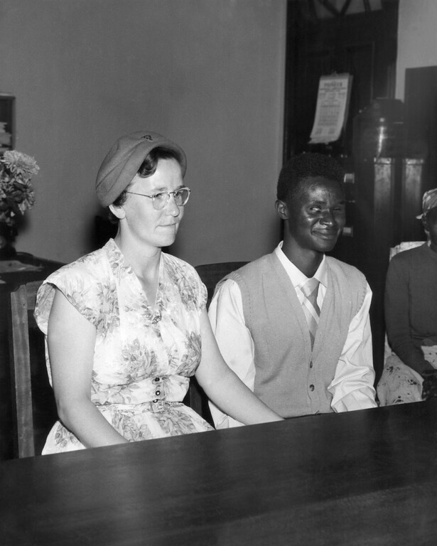 . Ruth Holloway, 35, from Nottingham, England, and John Kalendo Kimuyu, a 26-year-old blind African telephone operator, pose after their marriage in Nairobi, Kenya, Jan. 23, 1959. Only two African women relatives of the bridegroom attended the ceremony, held in the district commissioner\'s office. (AP Photo)