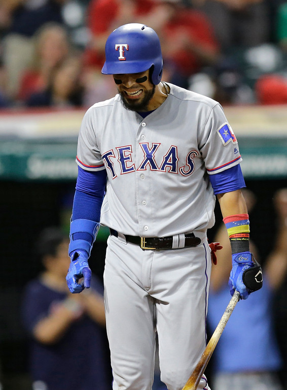 . Texas Rangers\' Robinson Chirinos reacts after striking out against Cleveland Indians relief pitcher Cody Allen in the ninth inning of a baseball game, Wednesday, June 28, 2017, in Cleveland. (AP Photo/Tony Dejak)