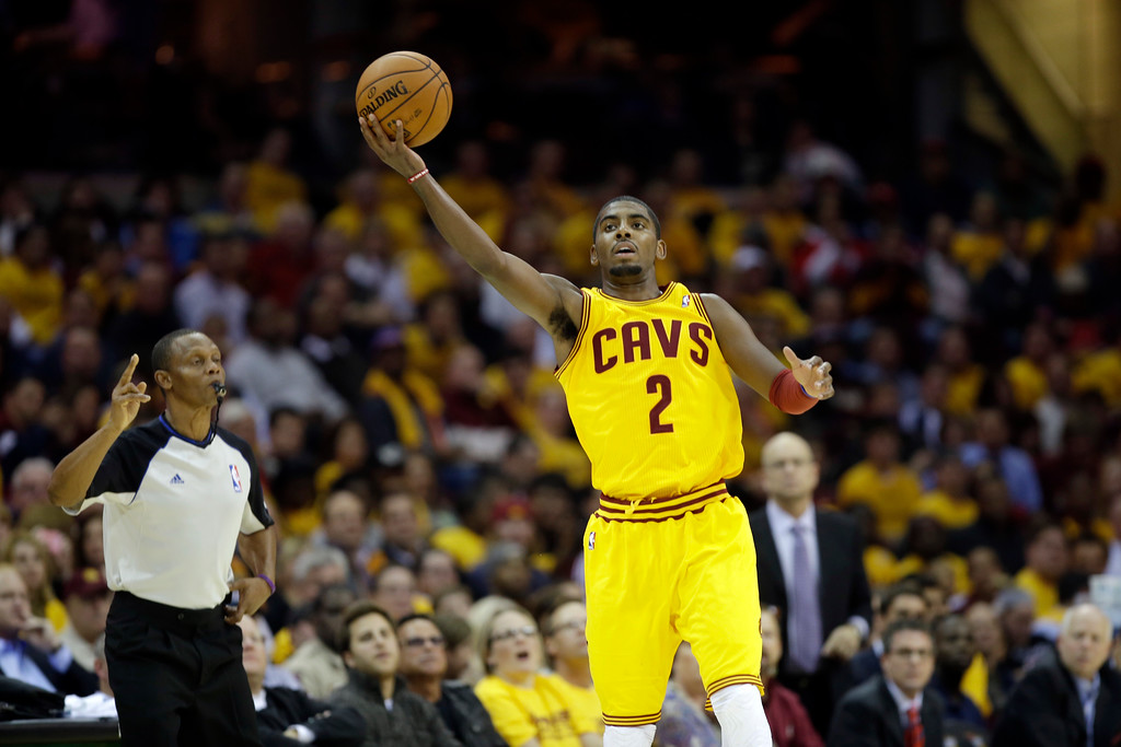 . Cleveland Cavaliers\' Kyrie Irving grabs an errant pass against the Washington Wizards in an NBA basketball game Tuesday, Oct. 30, 2012, in Cleveland. (AP Photo/Mark Duncan)