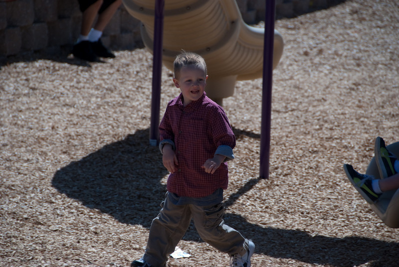 Alex runs off the slide