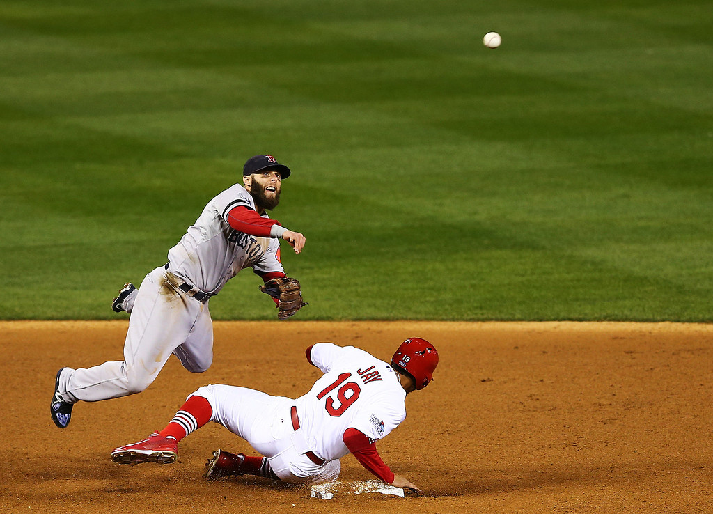 . Jon Jay #19 of the St. Louis Cardinals gets tagged out at second base by Dustin Pedroia #15 of the Boston Red Sox after David Freese #23 hit grounder into fielder\'s choice to shortstop in the fourth inning during Game Four of the 2013 World Series at Busch Stadium on October 27, 2013 in St Louis, Missouri.  (Photo by Elsa/Getty Images)