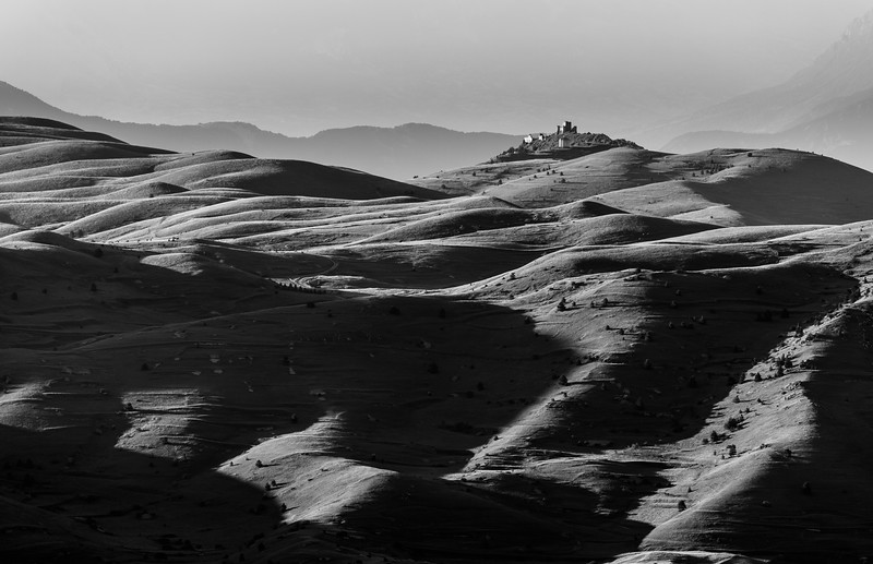 Rolling hills on Campo Imperatore with the old castle.