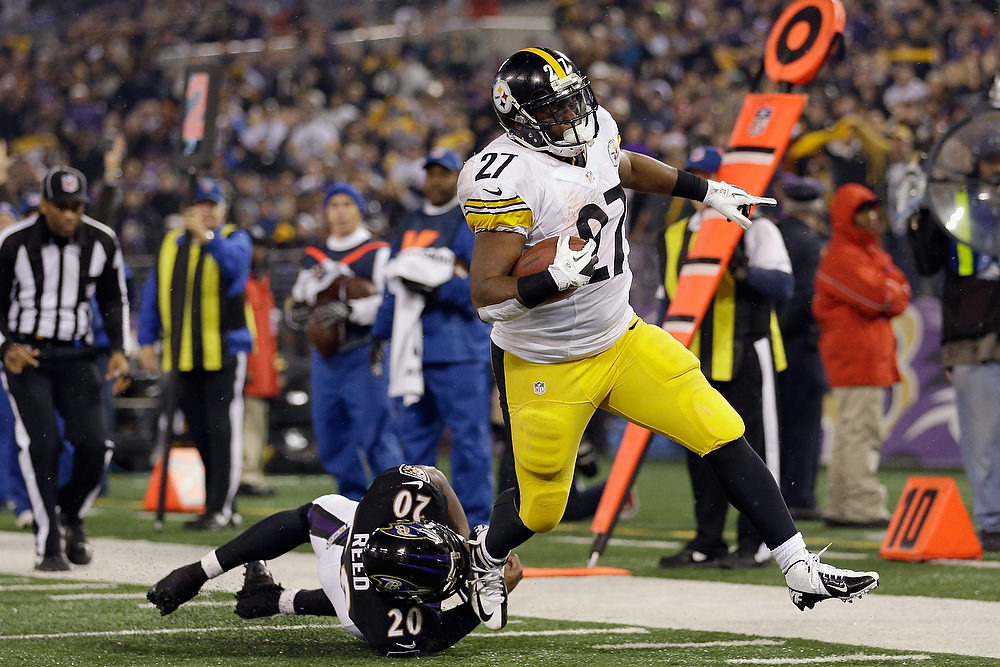 . Running back Jonathan Dwyer #27 of the Pittsburgh Steelers scores a touchdown as free safety Ed Reed #20 of the Baltimore Ravens tries to tackle him during the third quarter of the Steelers 23-20 win at M&T Bank Stadium on December 2, 2012 in Baltimore, Maryland.  (Photo by Rob Carr/Getty Images)