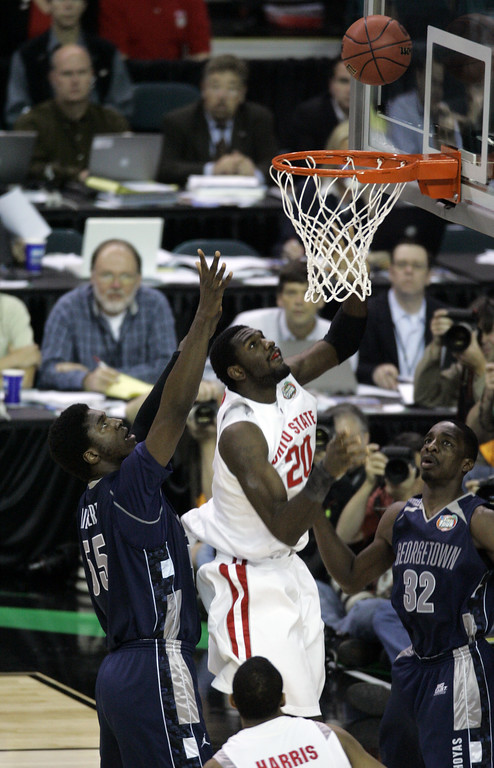 . Ohio State center Greg Oden scores against Georgetown center Roy Hibbert during a Final Four semifinal basketball game at the Georgia Dome in Atlanta, Saturday, March 31, 2007. (AP Photo/Charlie Neibergall)
