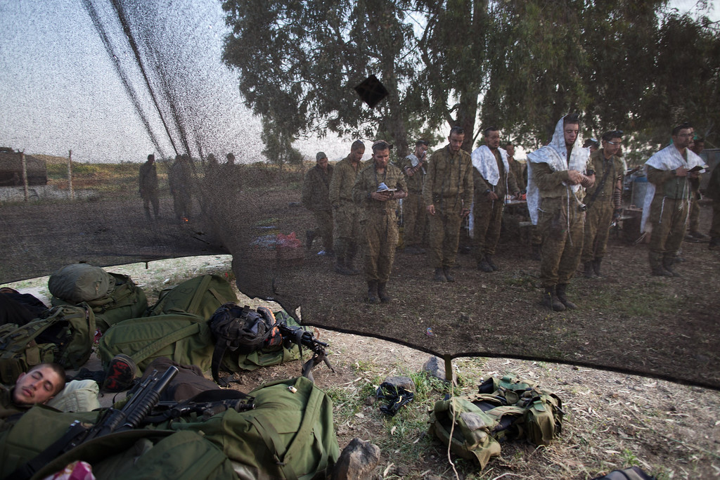 . GOLAN HEIGHTS - MAY 07:  Israeli soldiers of the Golani brigade pray while taking part in a military exercise May 7, 2013 near the border with Syria, in the Israeli-annexed Golan Heights. Syria has accused Israel of launching a series of airstrikes on targets near the Lebanon/Syria border, including an arms shipment and the Jamraya research centre, that was thought to produce chemical weapons.  (Photo by Uriel Sinai/Getty Images)
