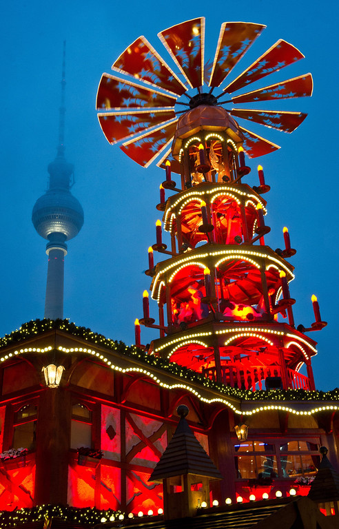. A Christmas pyramid stands at the Christmas market at Alexanderplatz in Berlin, Germany, 27 November 2013.  EPA/OLE SPATA