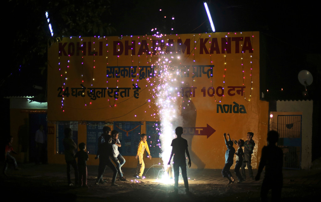. Indian children play with firecrackers to celebrate Diwali, the Hindu festival of lights, in New Delhi, India, Thursday, Oct. 19, 2017. Worried especially by the impact on the health of children, the Supreme Court this year banned the sale of firecrackers in the Indian capital and neighboring areas to prevent a toxic haze after the Diwali nights that has residents hiding indoors. (AP Photo/Altaf Qadri)