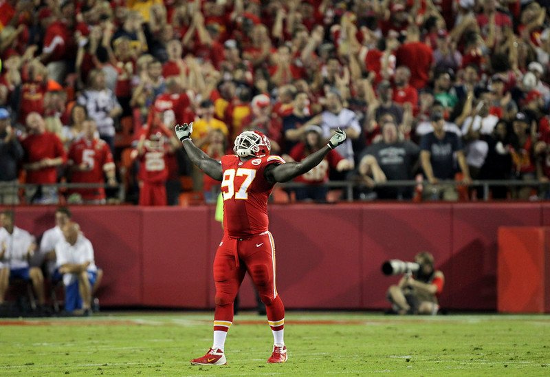 . Kansas City Chiefs defensive end Allen Bailey celebrates after teammate Sean Smith intercepted a pass and ran it back 34-yards during the third quarter of an NFL football game against the New England Patriots, Monday, Sept. 29, 2014, in Kansas City, Mo. (AP Photo/Ed Zurga)