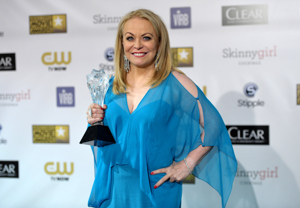 Description of . Jacki Weaver poses backstage with the award for best comedy movie for