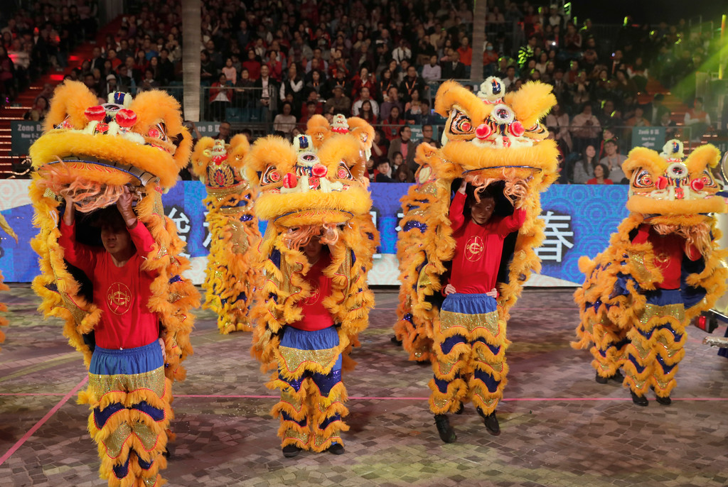 . Lion dance take part in a night parade to celebrate Chinese New Year in Hong Kong Friday, Feb. 16, 2018. The Lunar New Year this year marks the Year of the Dog in the Chinese calendar. (AP Photo/Vincent Yu)