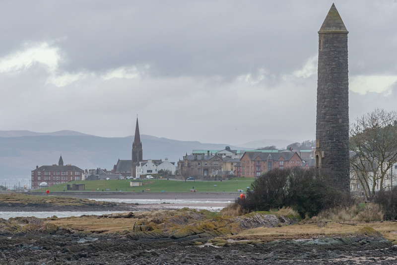 Largs Town and the Pencil Monument on a Hazy Wet Day in Scotland.