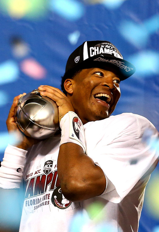 . Quarterback Jameis Winston #5 of the Florida State Seminoles celebrates on stage after defeating the Duke Blue Devils 45-7 in the ACC Championship game at Bank of America Stadium on December 7, 2013 in Charlotte, North Carolina. (Photo by Streeter Lecka/Getty Images)