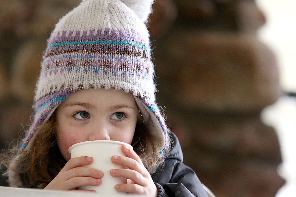. Enjoying a cookie at the Fitchburg Winterfest at Coggshall Park is Paige Dickhaut, 4. SENTINEL & ENTERPRISE/JOHN LOVE