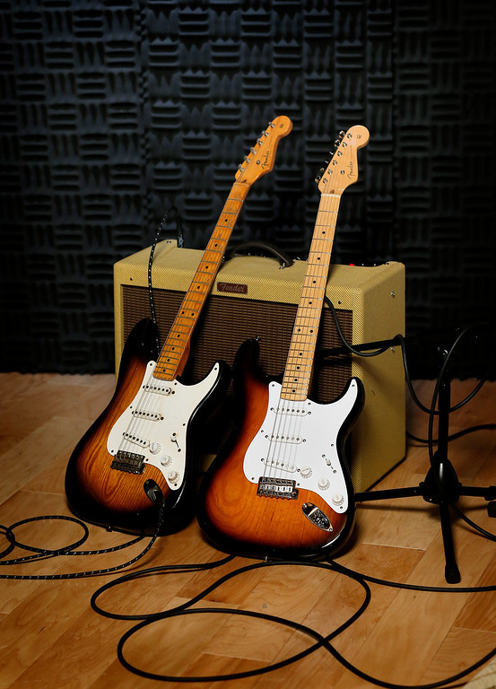 . An original 1954 Fender Stratocaster, left, is shown next to a 2014 model at a studio in Scottsdale, Ariz. on Friday, Jan. 10, 2014. Leo Fender developed the instrument in a small workshop in Fullerton, Calif. six decades ago. (AP Photo/Matt York)