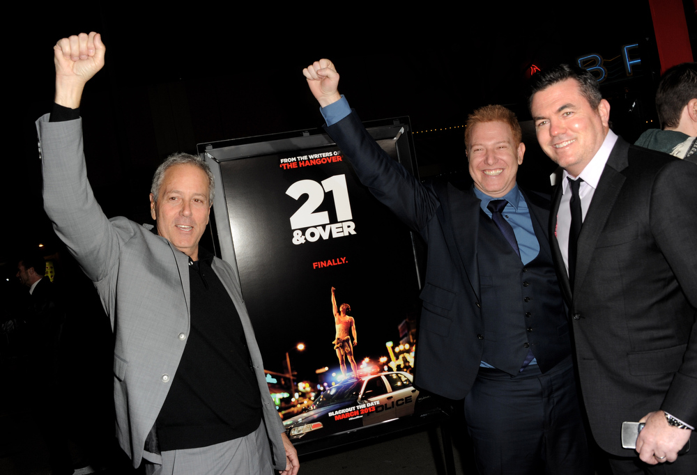 """. Producer David Hoberman, Ryan Cavanaugh, CEO and Tucker Tooley, President, Relativity Media arrive at the premiere of Relativity Media\'s \""""21 And Over\"""" at the Village Theatre on February 21, 2013 in Los Angeles, California.  (Photo by Kevin Winter/Getty Images)"""