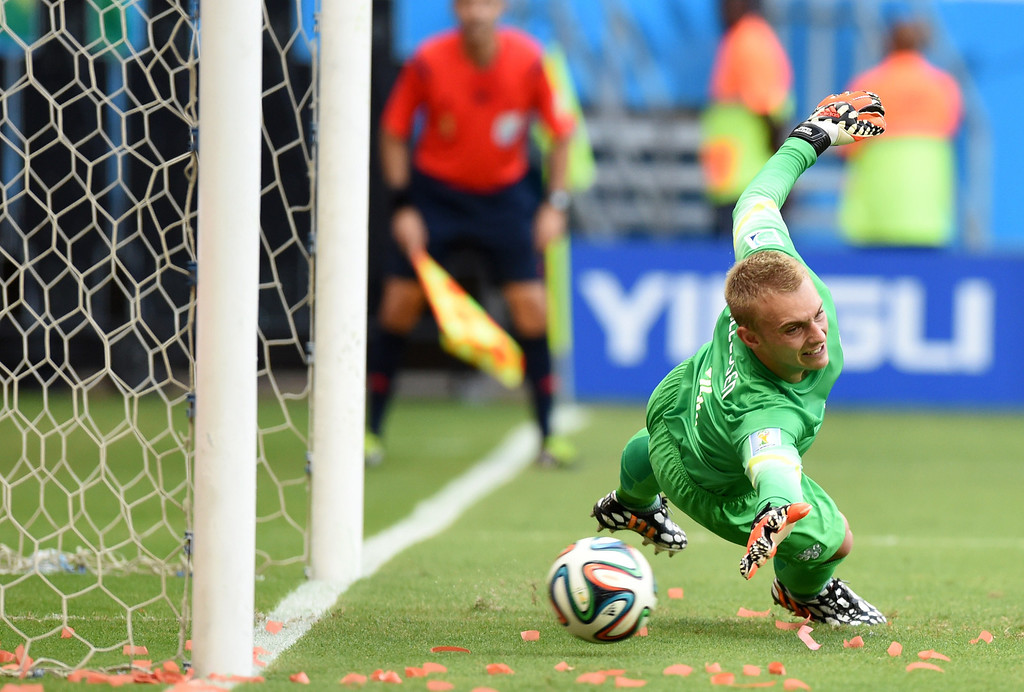 . Netherlands\' goalkeeper Jasper Cillessen fails to save a penalty during a Group B football match between Spain and the Netherlands at the Fonte Nova Arena in Salvador during the 2014 FIFA World Cup on June 13, 2014.  AFP PHOTO / JAVIER  SORIANO/AFP/Getty Images