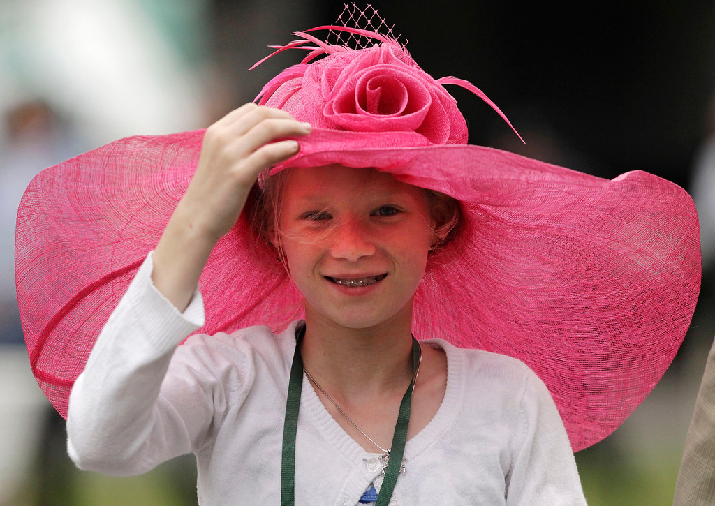 . Annalise Kolenda, 11, of Southborough, Mass. wears a hat while on the grounds at Belmont Park Saturday, June 8, 2013, in Elmont, N.Y. (AP Photo/Mark Lennihan)
