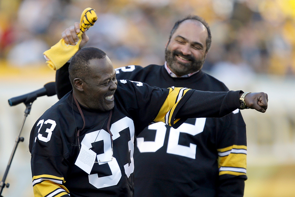 ". Pittsburgh Steelers Hall of Fame running back Franco Harris, right, and former running back John ""Frenchy\"" Fuqua enjoy a moment during a ceremony commemorating the 40th anniversary of Harris\'  \""Immaculate Reception\"" catch in the 1972 playoff game against the Oakland Raiders, during the halftime of an NFL football game between the Steelers and the Cincinnati Bengals in Pittsburgh, Sunday, Dec. 23, 2012. (AP Photo/Gene J. Puskar)"