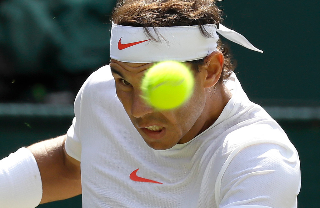 . Rafael Nadal of Spain returns the ball to Australia\'s Alex de Minaur during their men\'s singles match, on the sixth day of the Wimbledon Tennis Championships in London, Saturday, July 7, 2018. (AP Photo/Kirsty Wigglesworth)