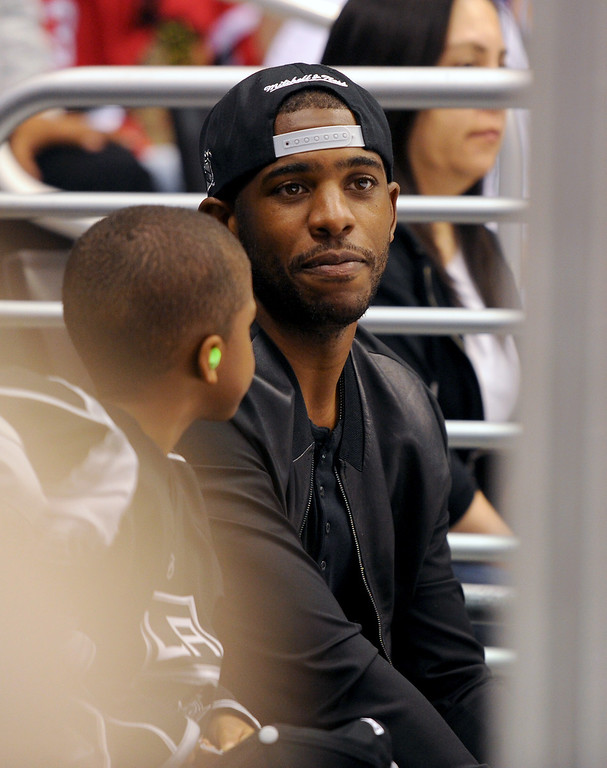 . Clippers point guard Chris Paul and his son attend the Kings-Blackhawks game six of the Western Conference Finals, Friday, May 30, 2014, at Staples Center. (Photo by Michael Owen Baker/Los Angeles Daily News)