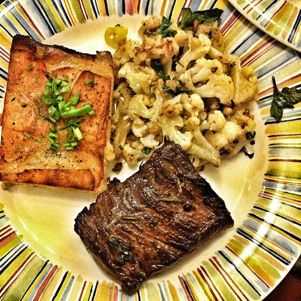 On the table tonite: skirt steak with potato pave; cauliflower with mint, pine nuts, hot banana peppers and Parmesan #foodie #food #jux