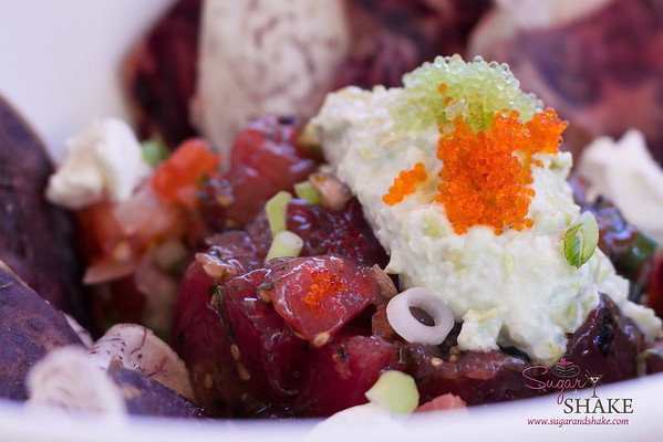 """Uncle Kimo's"" 'Ahi Poke Nachos at 'Ūmalu at the Hyatt Regency Maui Resort. Local line-caught 'ahi poke-style, guacamole, lomi lomi salsa, Surfing Goat chèvre cheese, fire cracker tobiko. © 2013 Sugar + Shake"