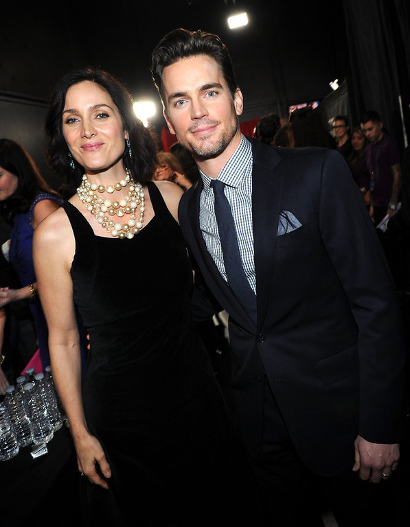 . (L-R) Actors Carrie-Anne Moss and Matthew Bomer attend the 39th Annual People\'s Choice Awards at Nokia Theatre L.A. Live on January 9, 2013 in Los Angeles, California.  (Photo by Michael Buckner/Getty Images for PCA)