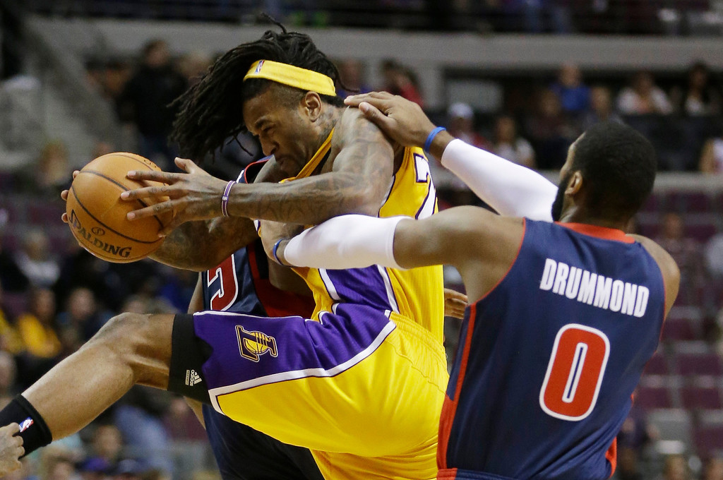 . Detroit Pistons center Andre Drummond (0) fouls Los Angeles Lakers center Jordan Hill on an inbound pass during the first quarter of an NBA basketball game at the Palace in Auburn Hills, Mich., Friday, Nov. 29, 2013. (AP Photo/Carlos Osorio)