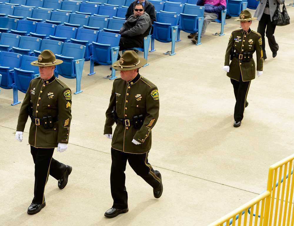 . Members of the Placer County Sheriff Department enter memorial services for San Bernardino County Sheriff Deputy Jeremiah MacKay at the San Manuel Amphitheater in Devore February 21, 2013.  GABRIEL LUIS ACOSTA/STAFF PHOTOGRAPHER.