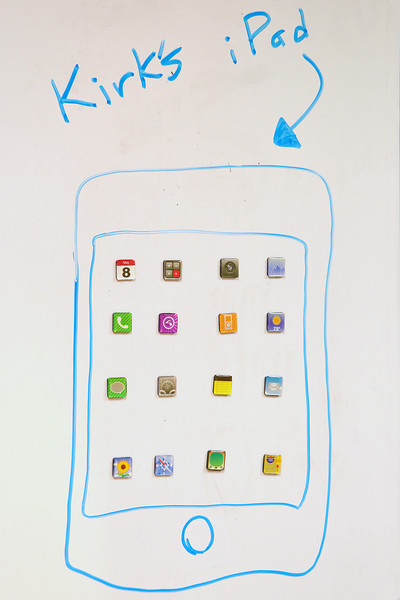 2012-4-2 ––– My guys in my department know I would love to have an iPad so one of them gave me this one. I had the app icons as magnets on my whiteboard. He organized them and then drew the iPad around them. Now I have that iPad I always wanted.