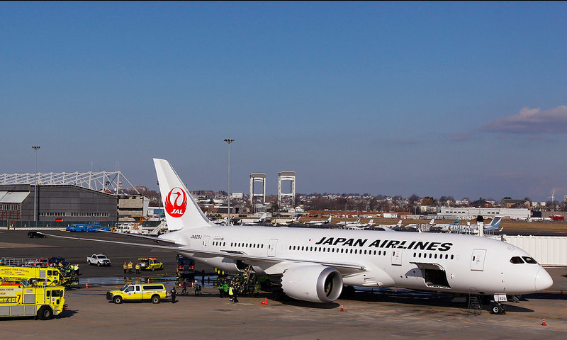 . A Japan Airlines Boeing 787 Dreamliner jet aircraft is surrounded by emergency vehicles while parked at a terminal E gate at Logan International Airport in Boston, Monday, Jan. 7, 2013. Boeing has a lot riding on the 787. The long-range jet promises a smoother travel experience and is 20 percent more fuel efficient than older models. After years of delays, Boeing has now delivered 49 of the planes, with almost 800 more on order.  (AP Photo/Stephan Savoia)