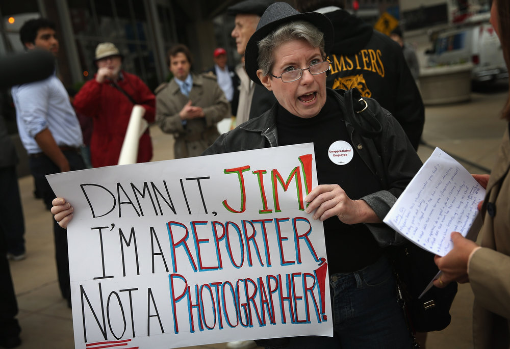 . Pioneer Press reporter Kathy Routliffe joins other demonstrators including union members, reporters, and photographers march outside the offices of the Chicago Sun-Times protesting the newspapers decision to eliminate its 28-member photography staff on June 6, 2013 in Chicago, Illinois. The newspaper chain plans to train their reporters to take pictures with iPhones to fill the void.  (Photo by Scott Olson/Getty Images)