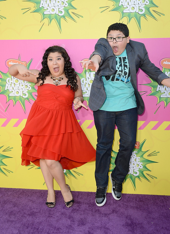 . LOS ANGELES, CA - MARCH 23:  Actors Raini Rodriguez (L) and Rico Rodriguez arrive at Nickelodeon\'s 26th Annual Kids\' Choice Awards at USC Galen Center on March 23, 2013 in Los Angeles, California.  (Photo by Frazer Harrison/Getty Images)