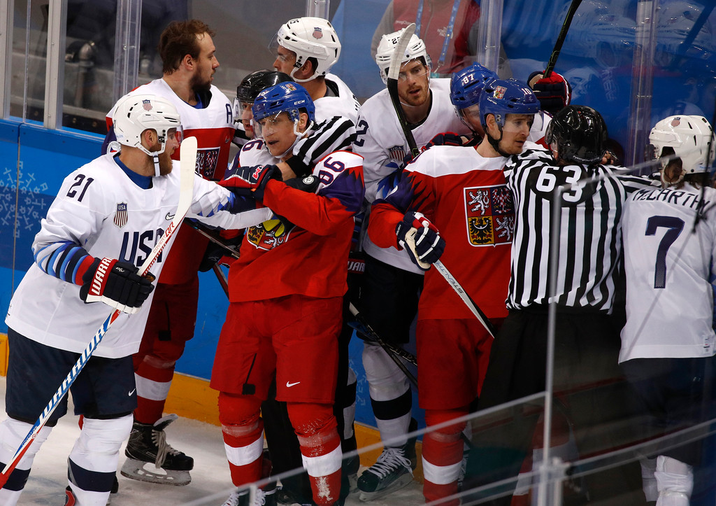 . Referees break up fight between the United States and the Czech Republic players during the first period of the quarterfinal round of the men\'s hockey game at the 2018 Winter Olympics in Gangneung, South Korea, Wednesday, Feb. 21, 2018. (AP Photo/Jae C. Hong)