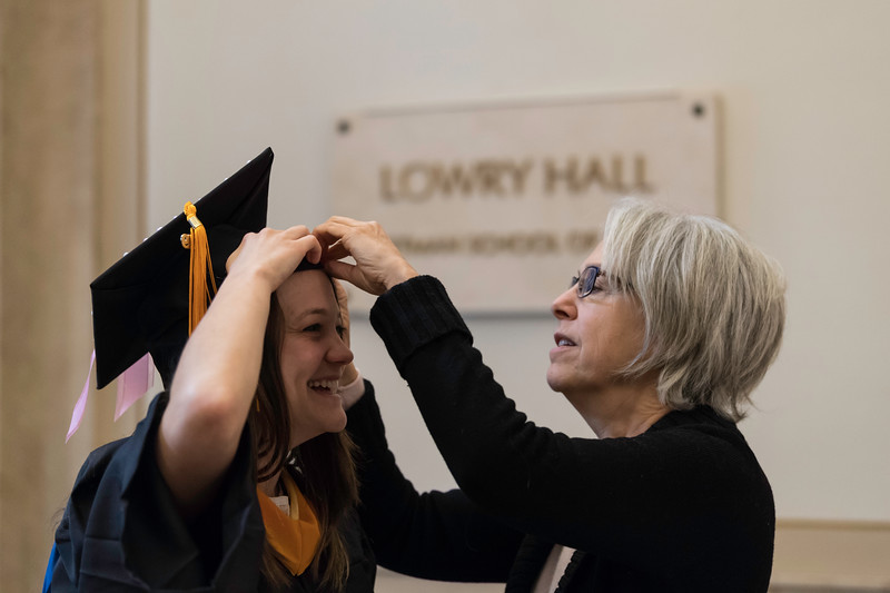 Natanya Kronish gets help with her regalia from her mom Myra. // Graduates get ready in Lowry Hall before the ceremony. // University of Rochester School of Nursing Commencement, Kodak Hall at Eastman Theatre May 17, 2019.  // photo by J. Adam Fenster / University of Rochester