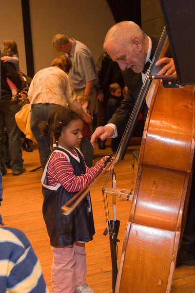 Ellie Briggs, bass, with child -- Hopkins Symphony Orchestra, March 2008