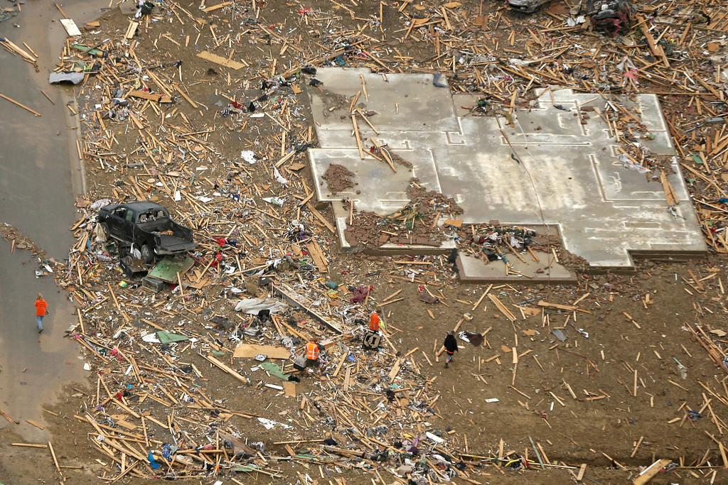 . A concrete slab and rubble are all that is left of a home in Vilonia, Ark., neighborhood Monday, April 28, 2014, after a tornado struck the town late Sunday. (AP Photo/Danny Johnston)