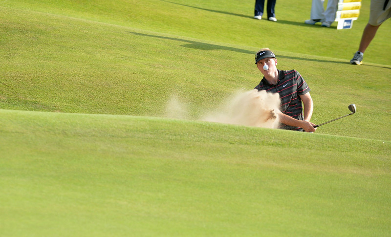 . US golfer Russell Henley plays out of a green-side bunker on the 15th hole during his first round 75, on the opening day of the 2014 British Open Golf Championship at Royal Liverpool Golf Course in Hoylake, north west England on July 17, 2014. (PAUL ELLIS/AFP/Getty Images)