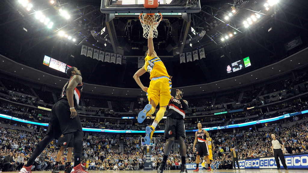 . Denver Nuggets center JaVale McGee (34) goes up for a dunk during the overtime against the Portland Trail Blazers  Tuesday, January 15, 2013 at Pepsi Center. John Leyba, The Denver Post