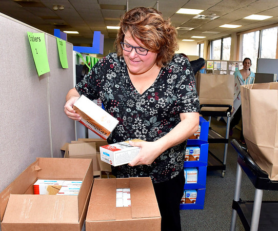 11/21/2019 Mike Orazzi | Staff Bristol Health's Women, Infants and Children program Melissa Dickau while assembling Thanksgiving food packages on Main Street Thursday on afternoon.