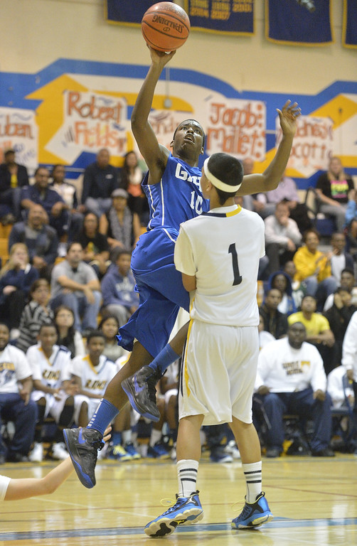 . LONG BEACH, CALIF. USA -- Gahr\'s Cory Johnson (10) takes a shot against Millikan\'s Thomas Pua (1) during their CIF-SS Divison 1-A playoff game in Long Beach on February 15, 2013. Millikan defeated Gahr, 74 to 64. Photo by Jeff Gritchen / Los Angeles Newspaper Group