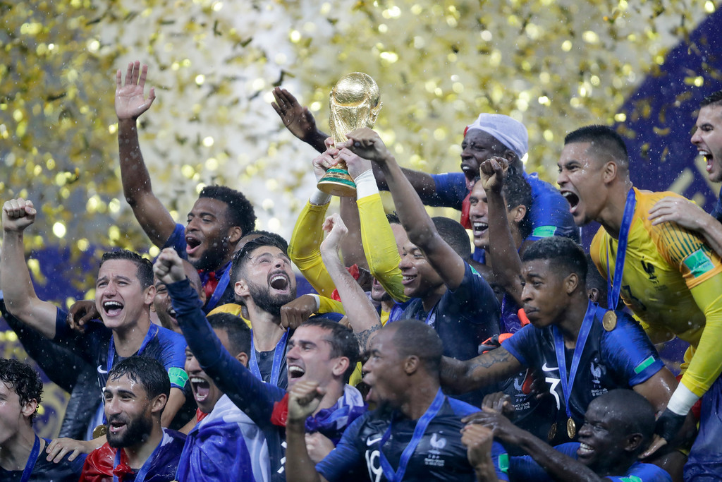 . French players celebrare with the trophy after the final match between France and Croatia at the 2018 soccer World Cup in the Luzhniki Stadium in Moscow, Russia, Sunday, July 15, 2018. (AP Photo/Natacha Pisarenko)