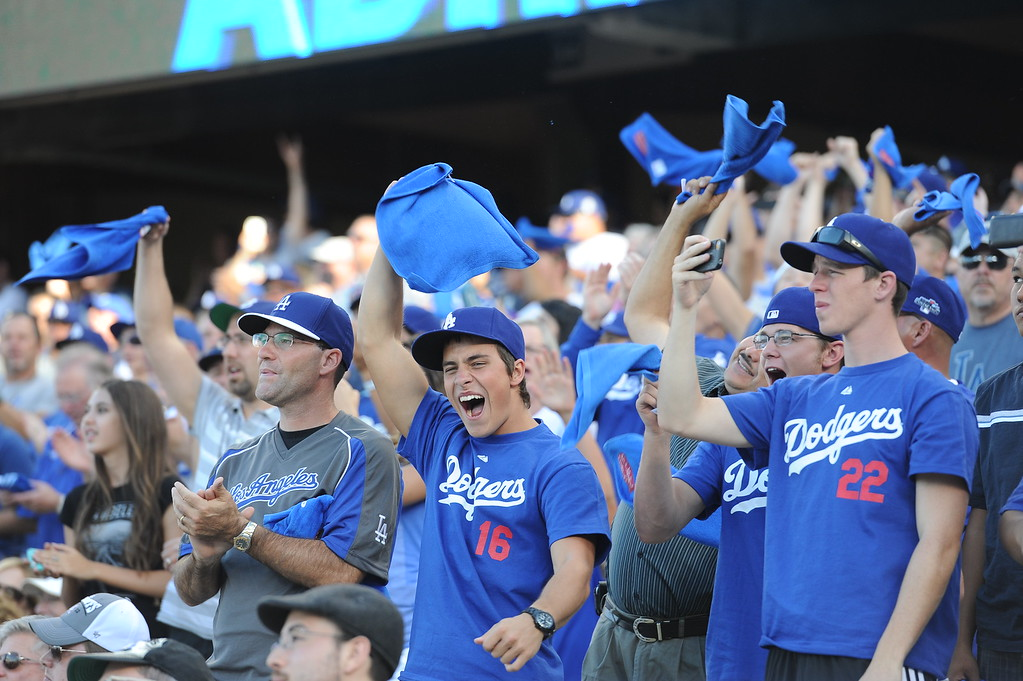. Los Angeles Dodger fans cheer at the beginning of game 3 of the NLDS at Dodger Stadium Sunday, October 6, 2013. (Photo by Hans Gutknecht/Los Angeles Daily News)