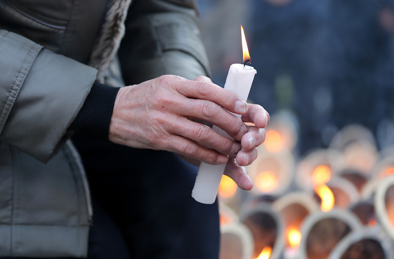 . A man holds a candle as he commemorates victims of Great East Japan Earthquake and Tsunami in front of Kobe\'s light of hope memorial  on March 11, 2014 in Kobe, Japan. On March 11 Japan commemorates the third anniversary of the magnitude 9.0 earthquake and tsunami that claimed more than 18,000 lives, and subsequent nuclear disaster at the Fukushima Daiichi Nuclear Power Plant.  (Photo by Buddhika Weerasinghe/Getty Images)