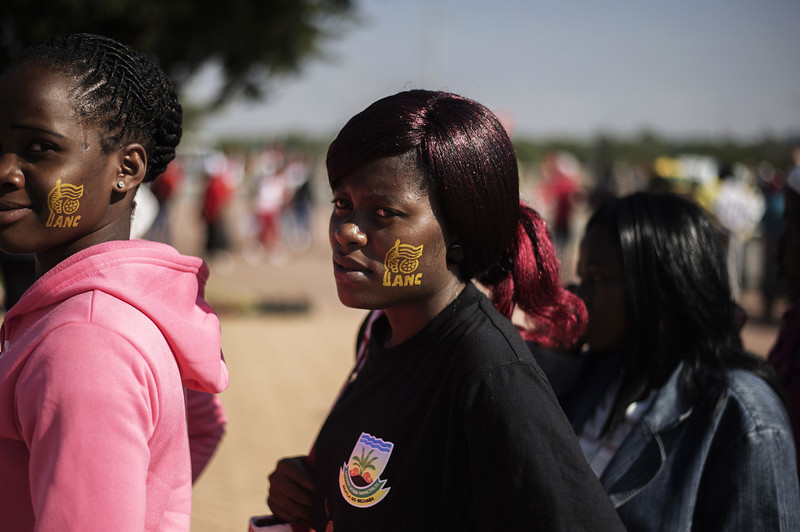 . Supporters of South Africa\'s ruling African National Congress (ANC) queue outside the Peter Mokaba Stadium in Polokwane to attend a May Day celebration organized by the ANC, the Confederation of the South African Union and the South African Communist Party on May 1, 2014. (GIANLUIGI GUERCIA/AFP/Getty Images)