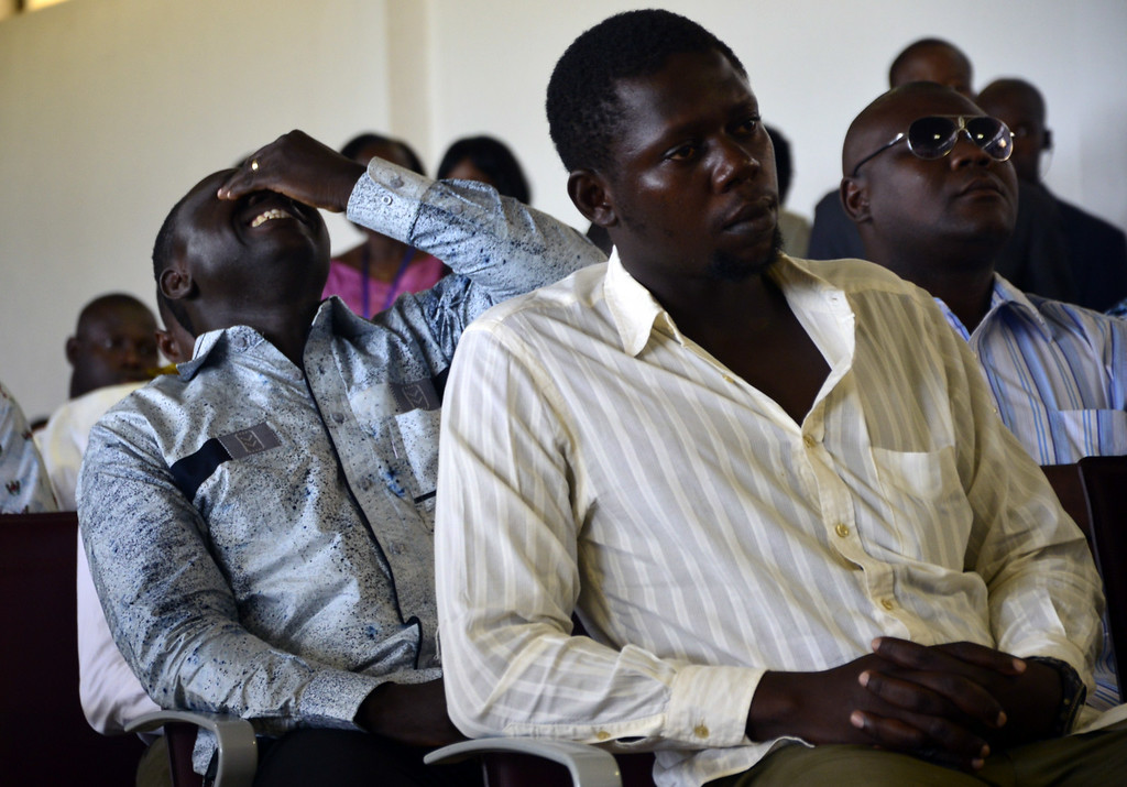 . Relatives of passengers killed in the crash of the Air Algeria flight AH017 attend a crisis cell meeting at Ouagadougou airport in Burkina Faso on July 25, 2014. France announced on July 25 there were no survivors among the 118 people on board the Air Algerie flight that crashed over Mali, saying bad weather was the likely cause of the disaster.   AFP PHOTO / AHMED  OUOBA/AFP/Getty Images