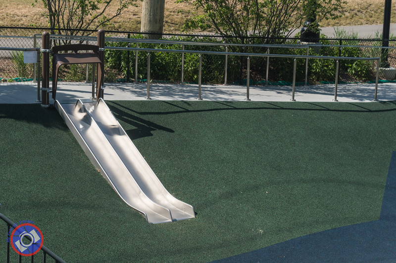 The Wheelchair Accessible Double Slide in the Promenade Park Children's Playground (©simon@myeclecticimages.com)