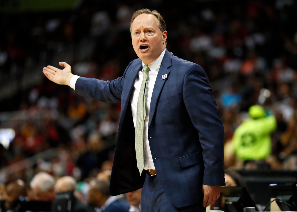 . Atlanta Hawks head coach Mike Budenholzer reacts in the second half of an NBA basketball game against the Cleveland Cavaliers on Sunday, April 9, 2017, in Atlanta. The Hawks won in overtime 126-125. (AP Photo/Todd Kirkland)