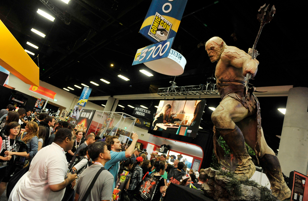 . A model looms over Comic-Con attendees during the Preview Night event on Day 1 of the 2013 Comic-Con International Convention on Wednesday, July 17, 2013 in San Diego, Calif. (Photo by Chris Pizzello/Invision/AP)